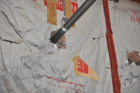 The large hole shown around the pipe here is allowing air to move right through this insulation.