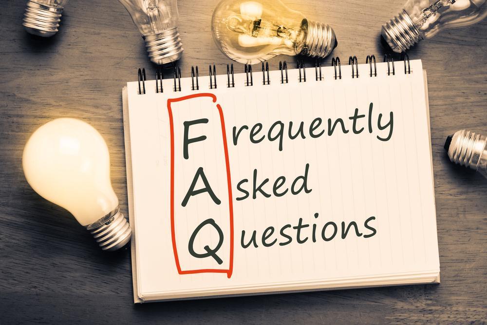 FAQ Notepad With Lightbulbs