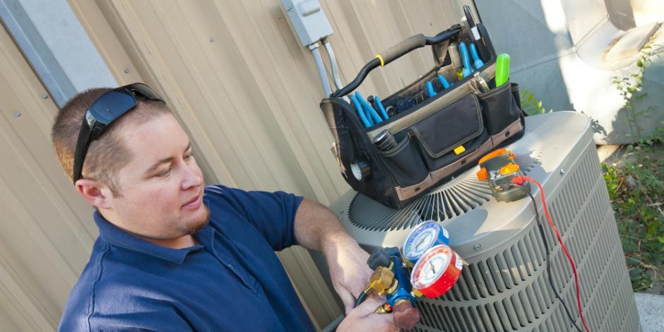 Technician working on heat pump