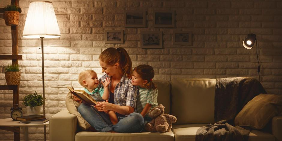 Mother reading with child on couch